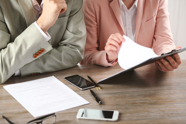 Divorcing couple in Edmonton Alberta, negotiating property division with help of Family Law lawyer Belal Najmeddine, who has a law office in Edmonton.